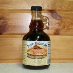A glass gallone full of delectable pure maple syrup